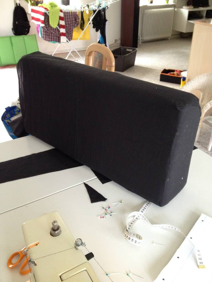 The cushions are on upholstered in new fabrics in black color