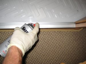 Greasing the bottom rail to sliding door with Super Lube DRI-Film